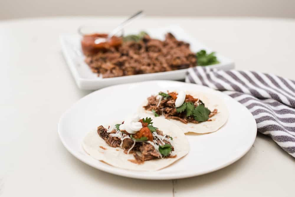 plated slow cooker flank steak tacos