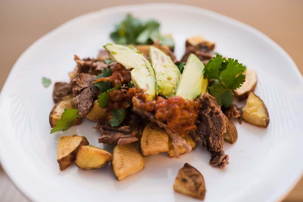 roasted potatoes topped with flank steak avocado and salsa paleo whole30