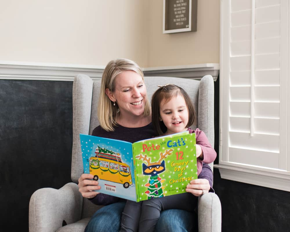 Mom and toddler reading Pete the Cat's 12 Groovy Days of Christmas