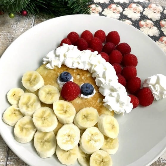 Santa pancakes loaded with fruit.