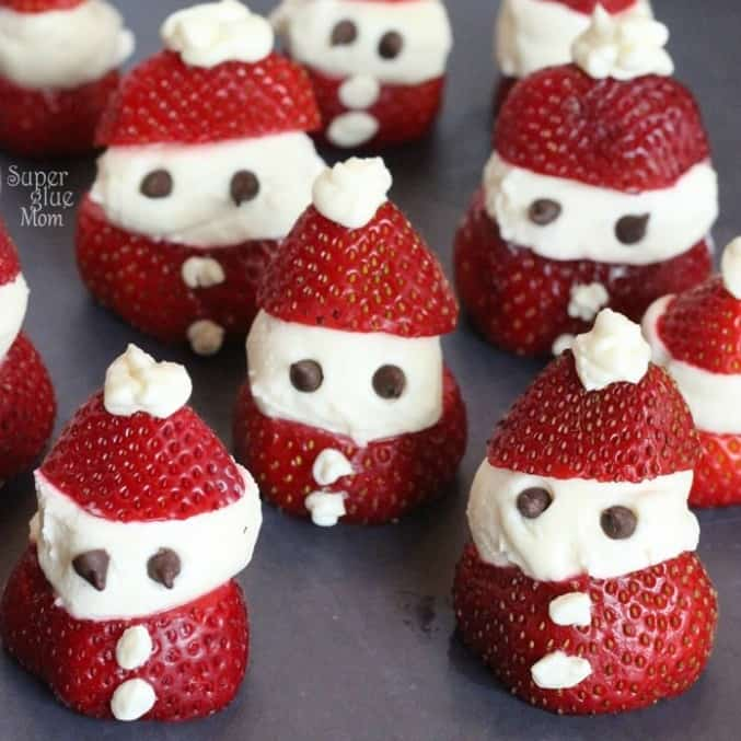 Cheesecake filled strawberry santa snacks.