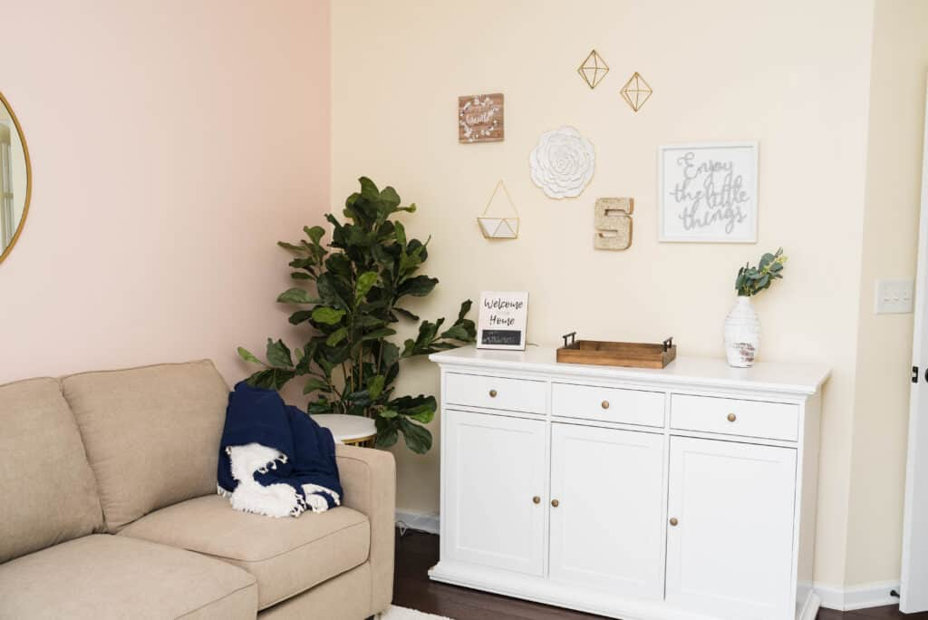 White farmhouse sideboard with white and gold accent decor