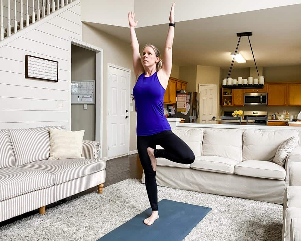 healthy lifestyle blogger amanda seghetti demonstrates tree pose