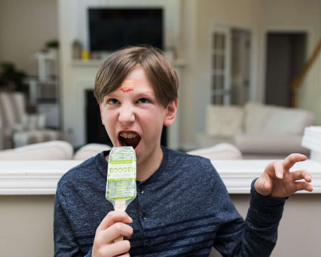 Kaiden as Zo Zo Zombie eating booger lollipop - Amanda Seghetti