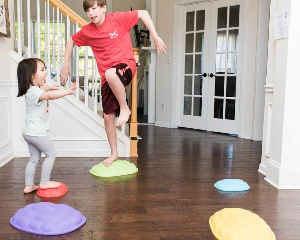balancing home workouts for kids on turtle rocks