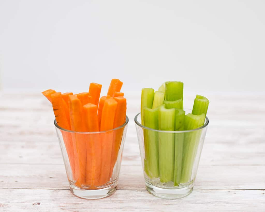 orange and green carrot and celery lightsabers