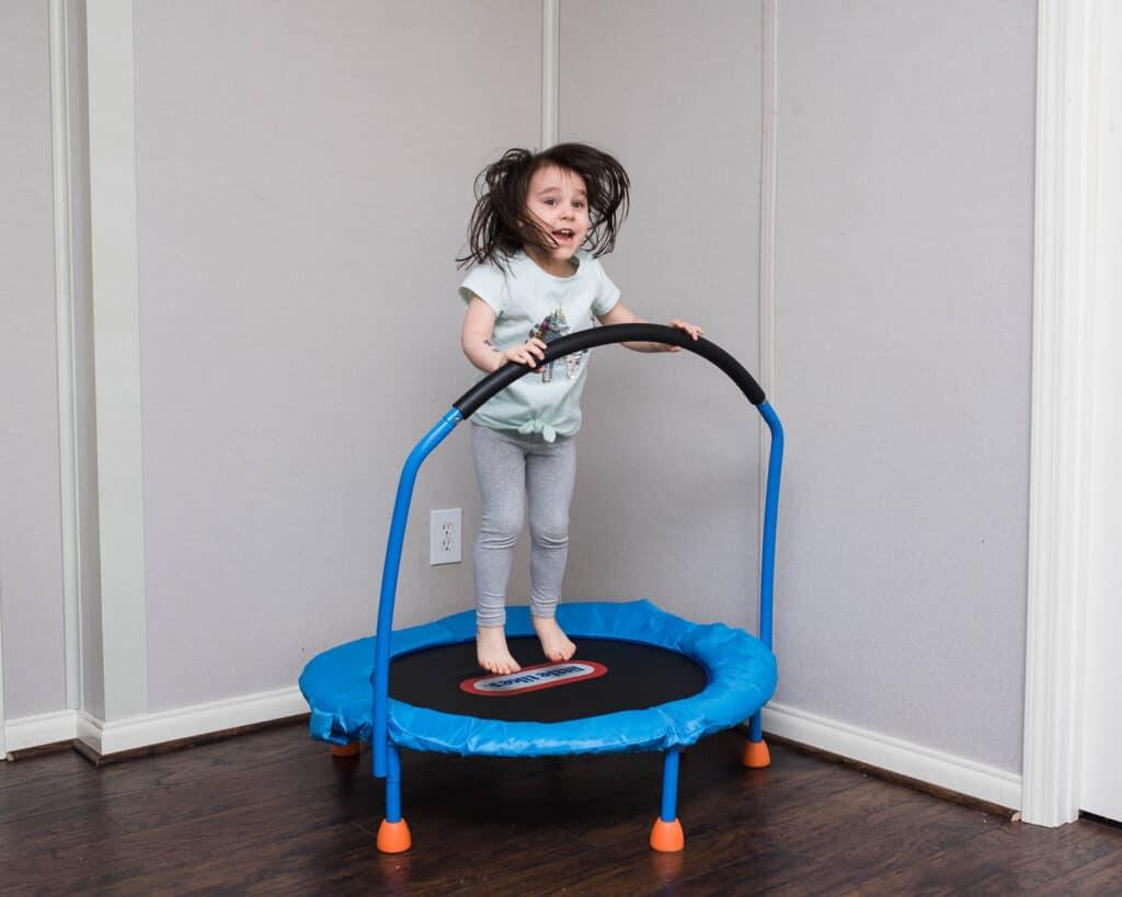 preschooler jumping on little tikes mini trampoline