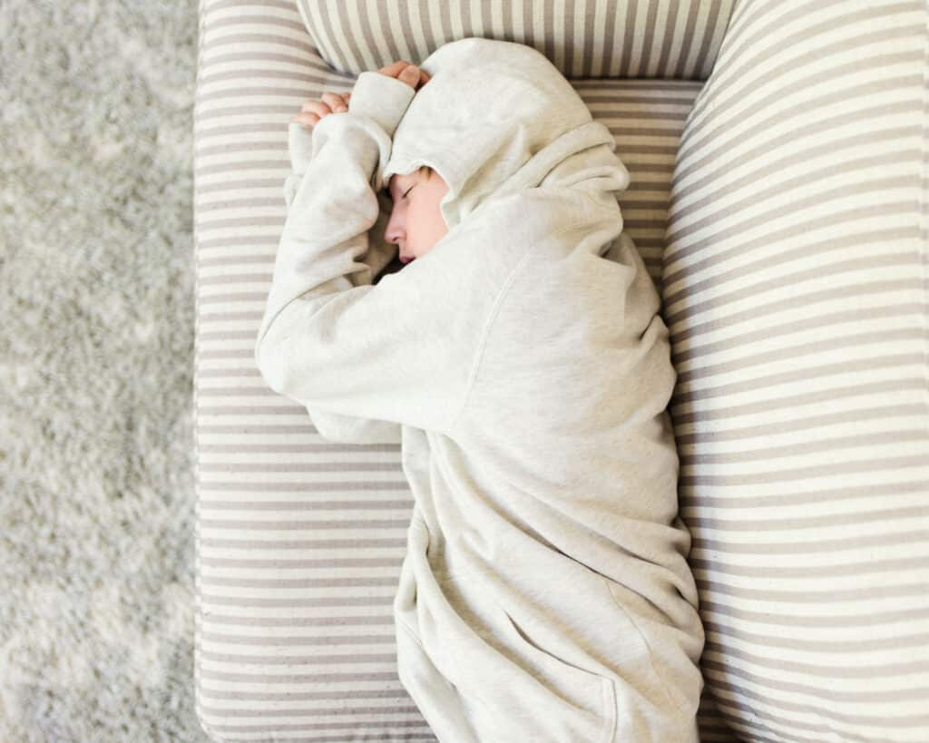 teen napping on couch while sheltering at home