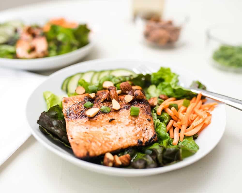 Salmon salad with sriracha almonds