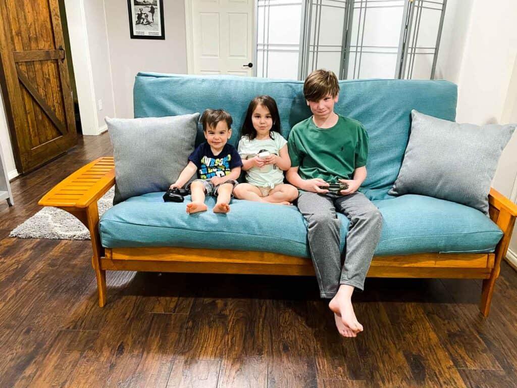 kids on futon in basement media room