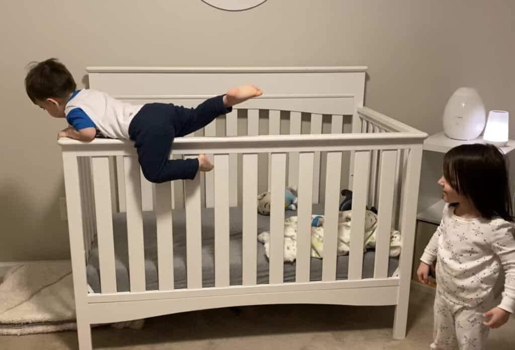 toddler climbing out of crib