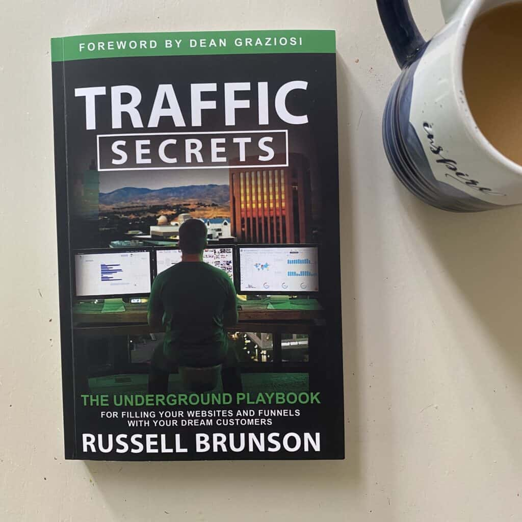 Traffic secrets book and a cup of coffee