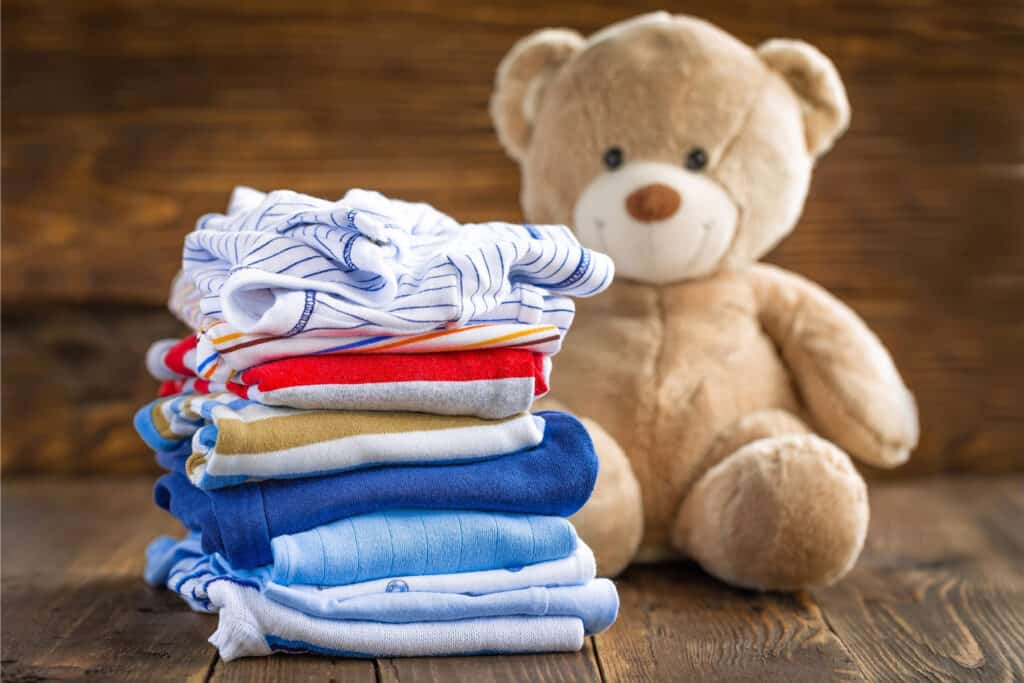 baby clothes photo with teddy bear