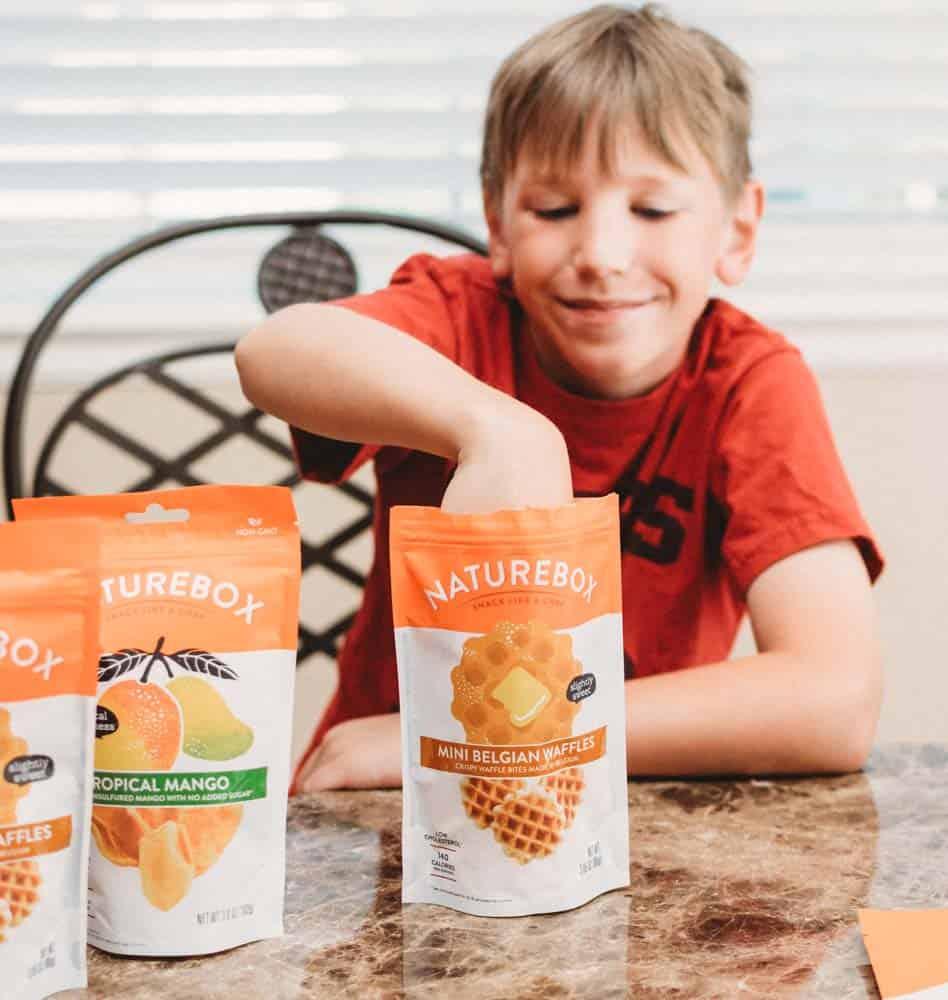 boy with snacks in flexible packaging