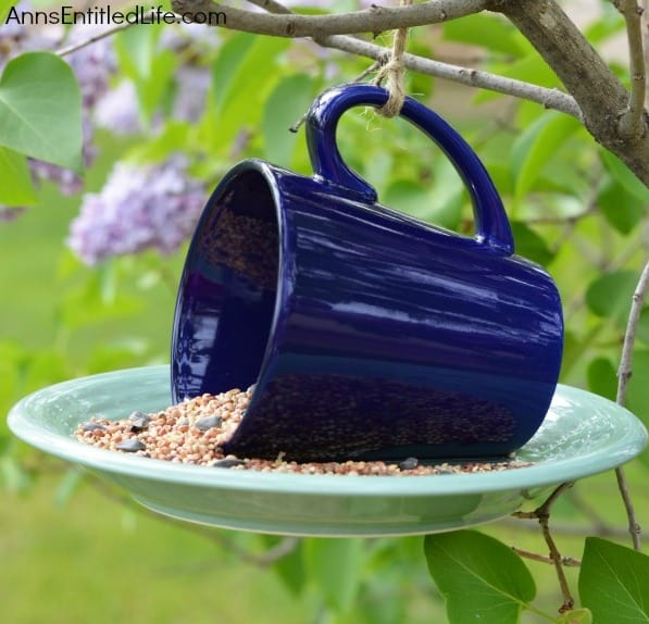 Bird feeder made from a discarded coffee mug and dessert plate.