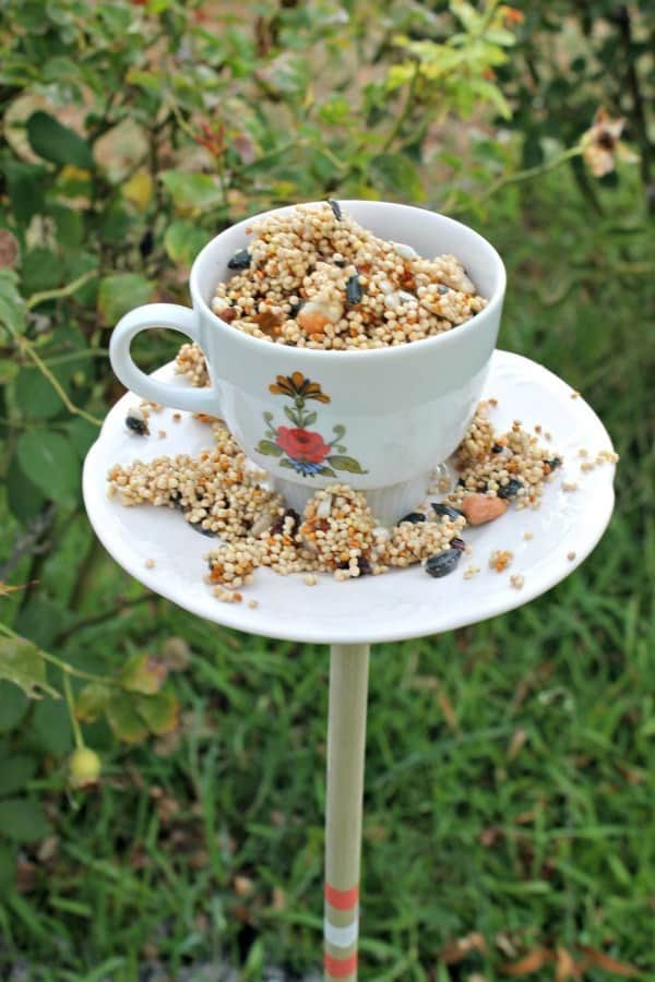 A tea cup and saucer are glued together to make a bird feeder.