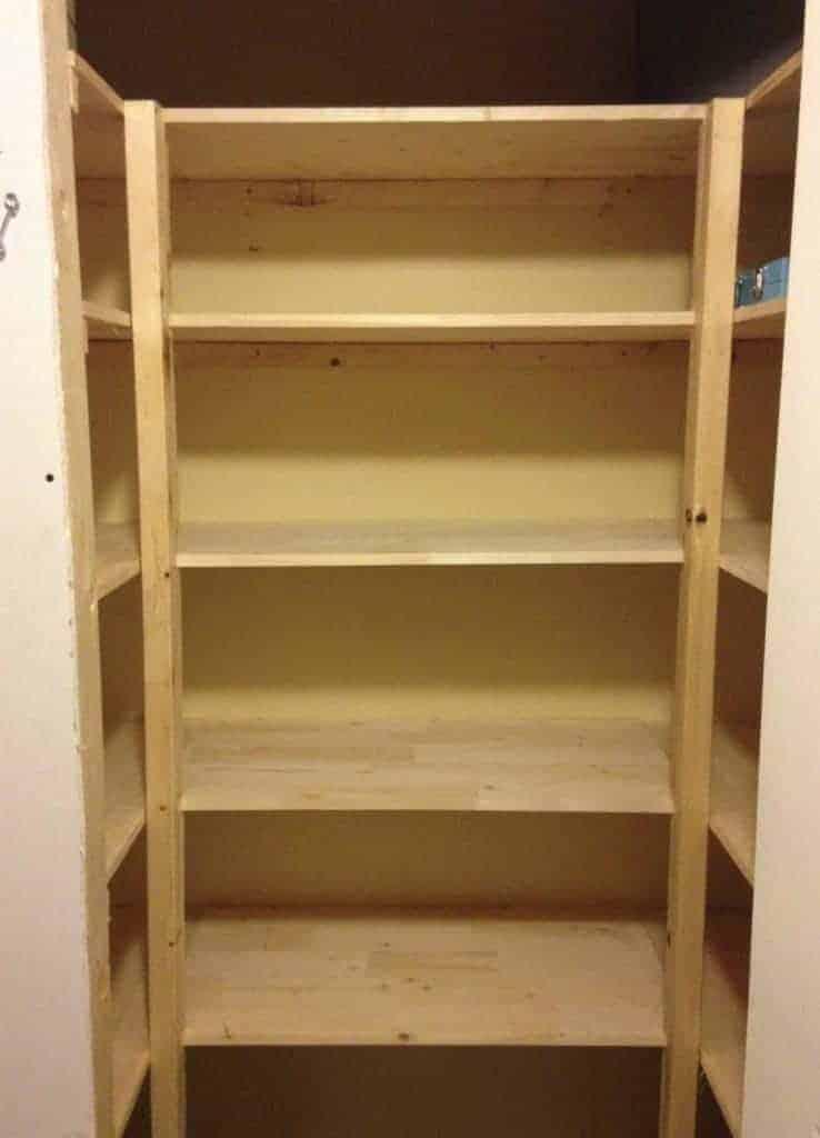 DIY wooden shelves in kitchen pantry