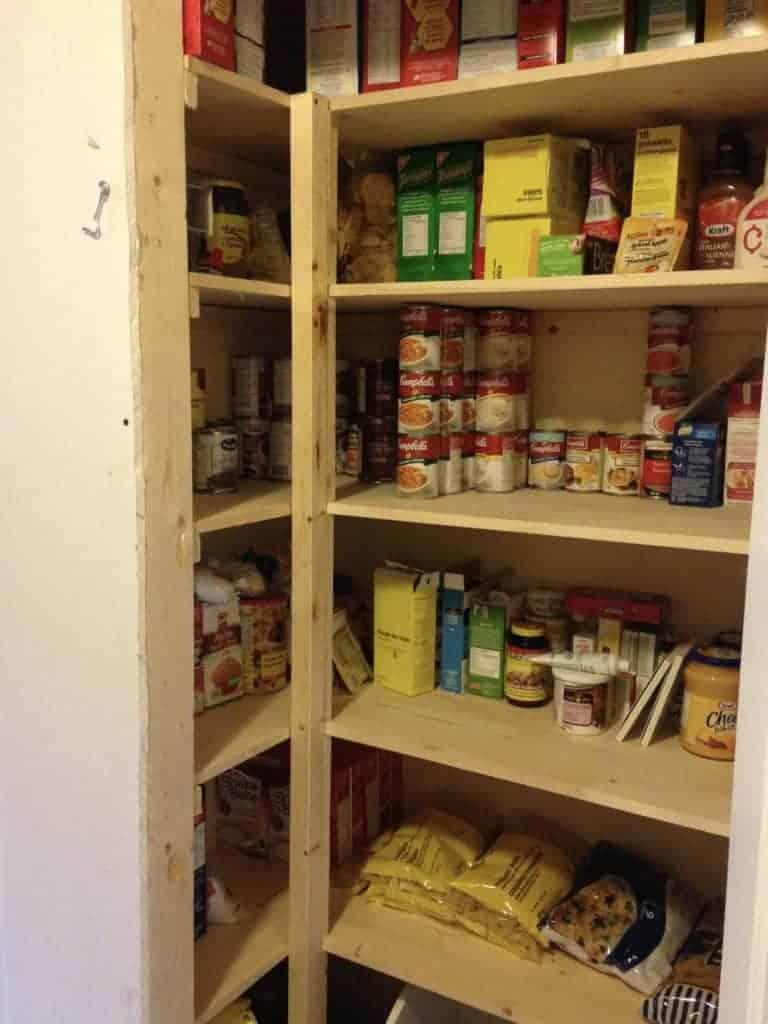 pine wood shelving in pantry