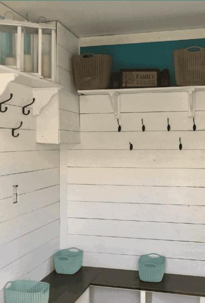 DIY mudroom bench featuring shiplap walls