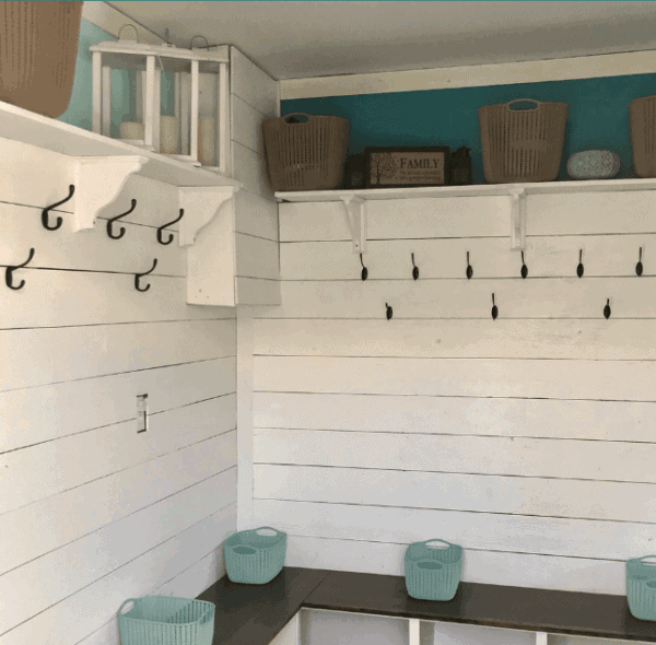 DIY mudroom bench featuring shiplap walls