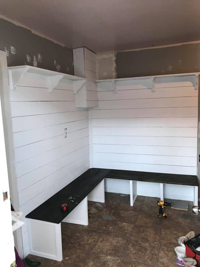 mudroom entryway with shiplap walls