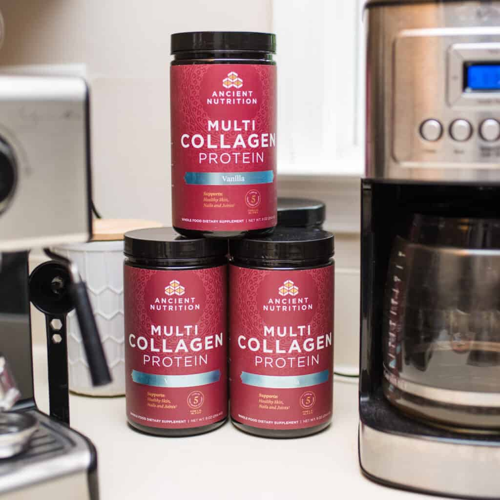 stack of ancient nutrition collagen next to coffee maker