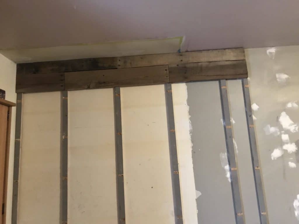 start adding pallet boards to wall