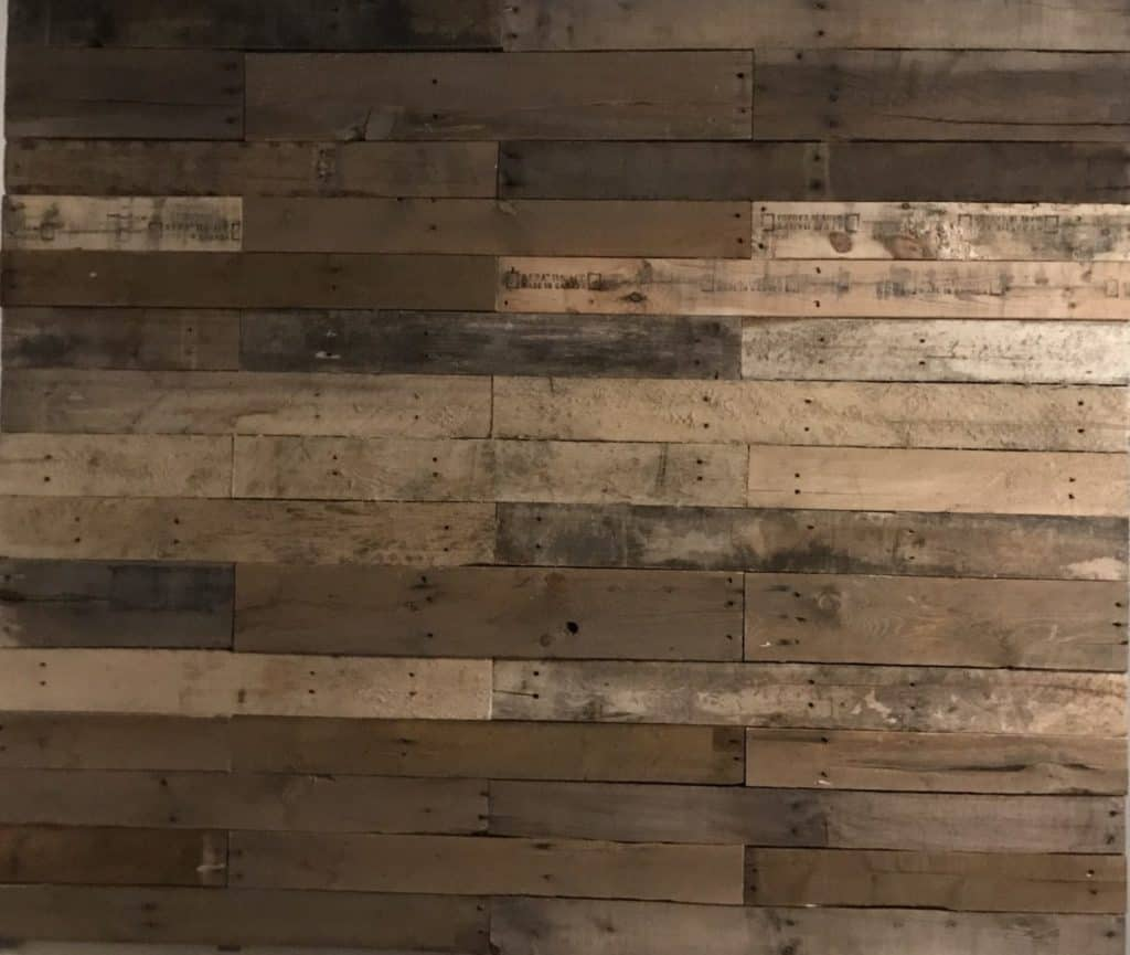 completed DIY pallet wall in laundry room makeover