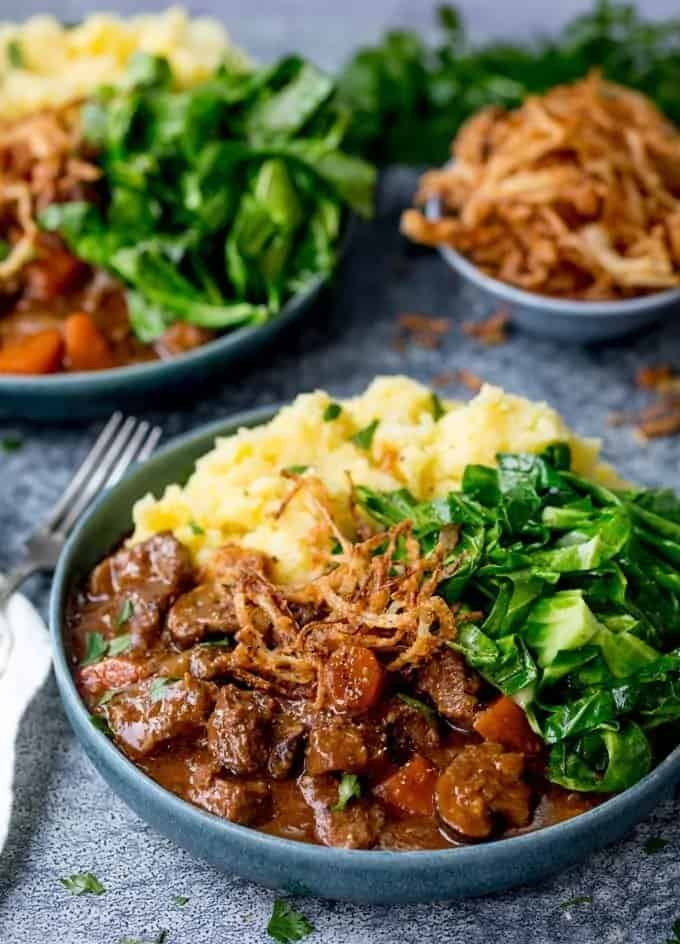 yummy beef stewed in Guinness and topped with crispy onions is the perfect crockpot recipe for fall.