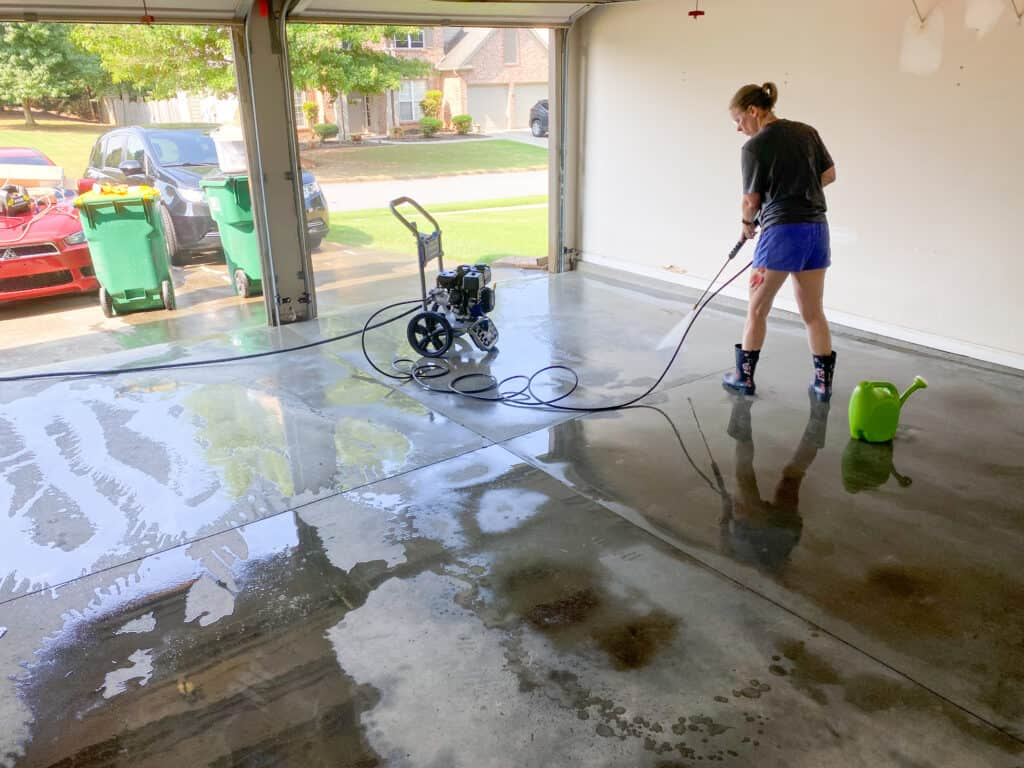cleaning and pressure washing garage floor before paint and epoxy