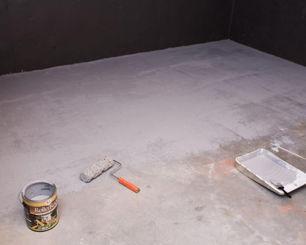 half of concrete floor painted