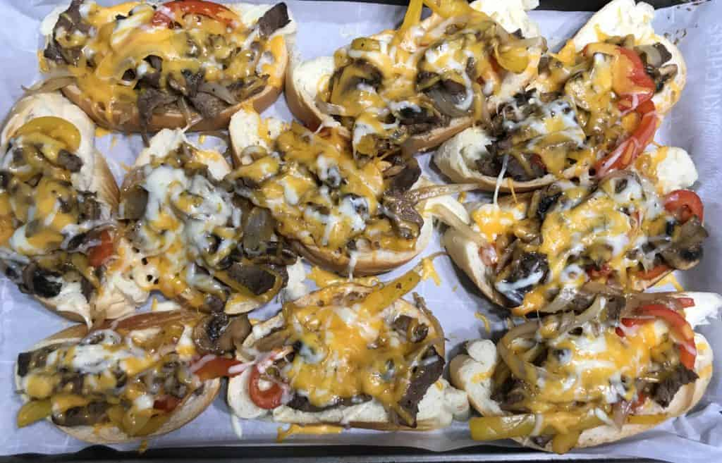 finished philly cheesesteak sandwiches