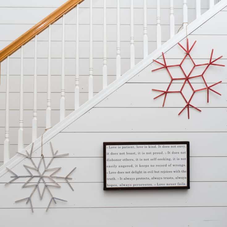 DIY craft stick snowflake wreaths hanging on shiplap wall SQUARE scaled - Amanda Seghetti