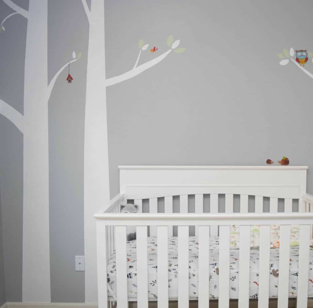 Woodland wall mural in baby nursery