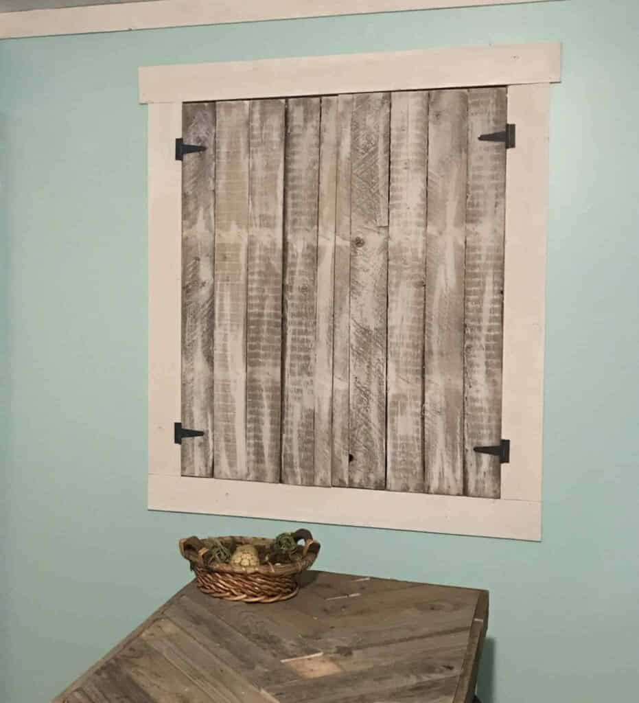 Our farmhouse shutters when closed give a shabby chic vibe to the room while still maintaining some brightness.