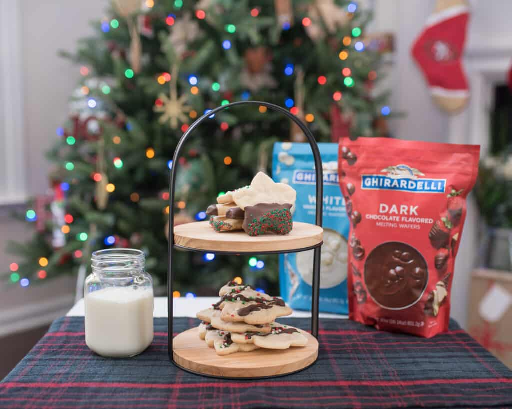 cookies and milk in front of tree