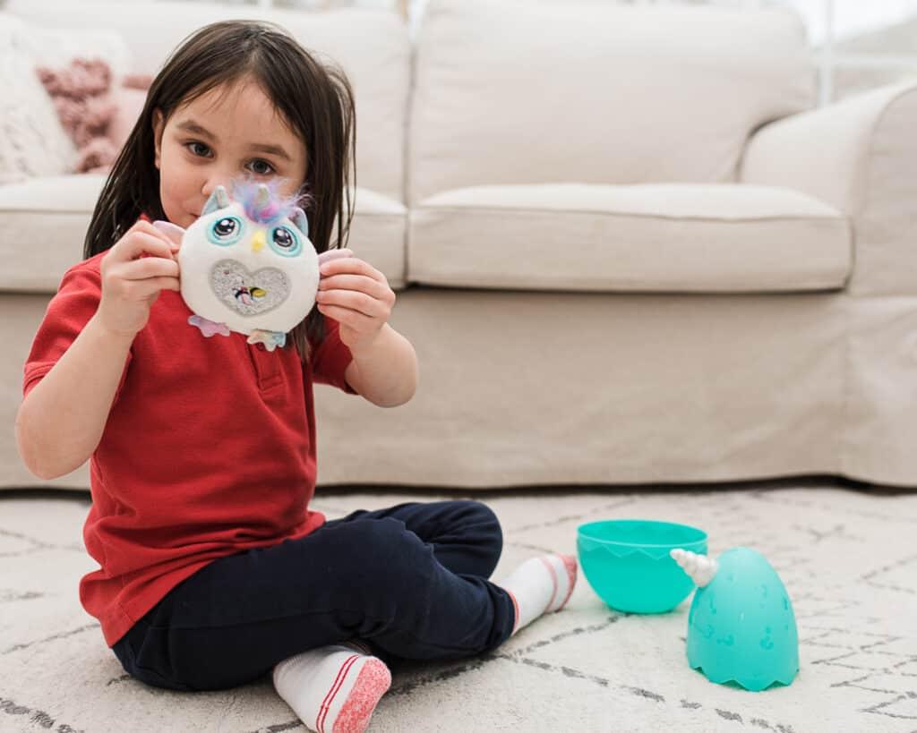 girl playing with Rainbocorn
