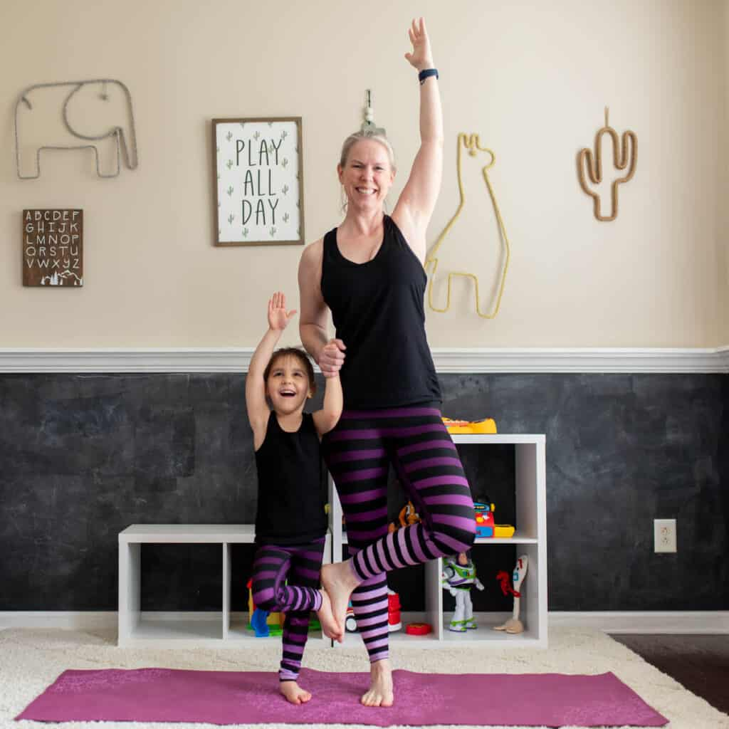 Mom and kid partner tree pose square
