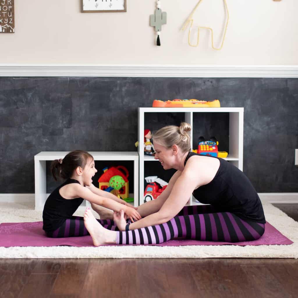 Mom and kid yoga stretch square