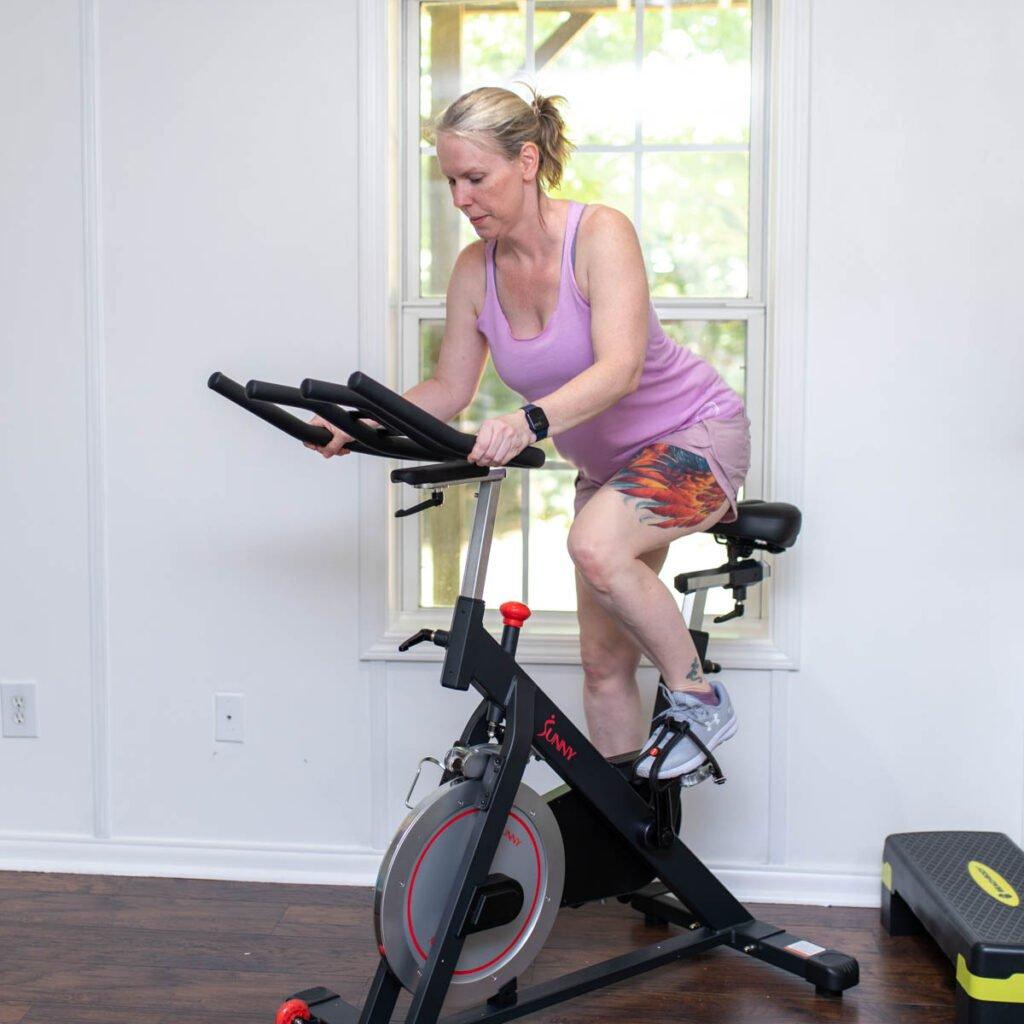 Amanda Seghetti on stationary bike exercise